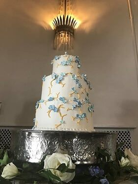 Three tiered wedding cake with hand crafted hydrangea flowers