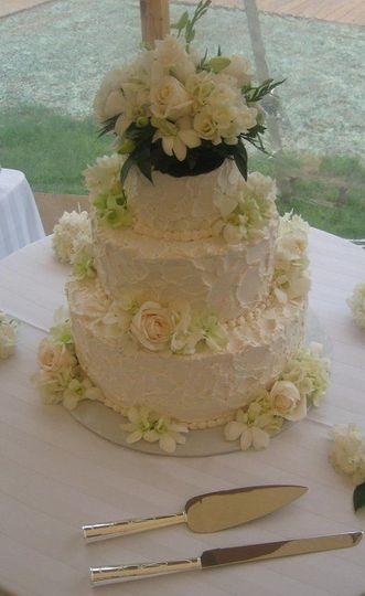 Palette texture wedding cake with fresh floral design