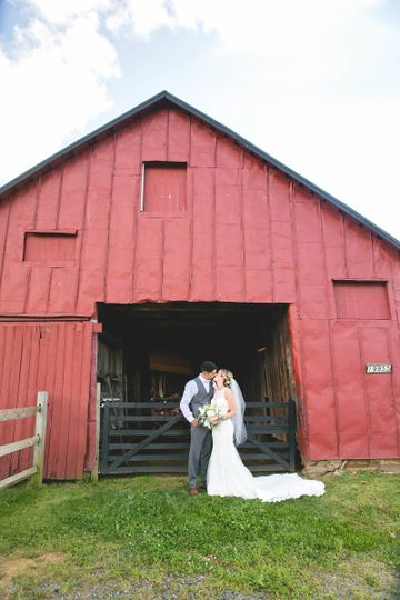 Kissing by the barn