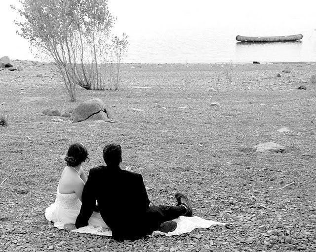 Bride and groom sitting and looking at the waters