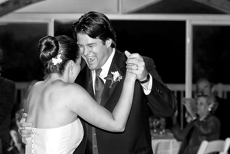 first dance with bride and laughing groom