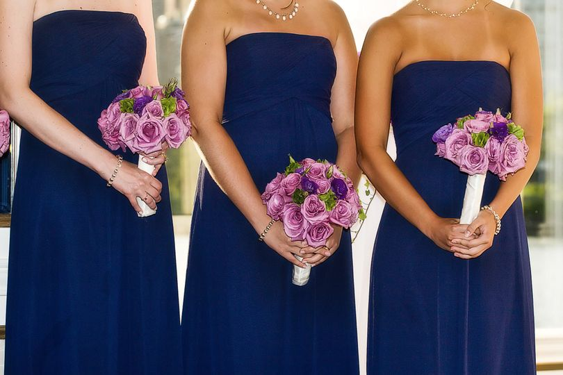 bridesmaids in strapless blue dresses and purpl