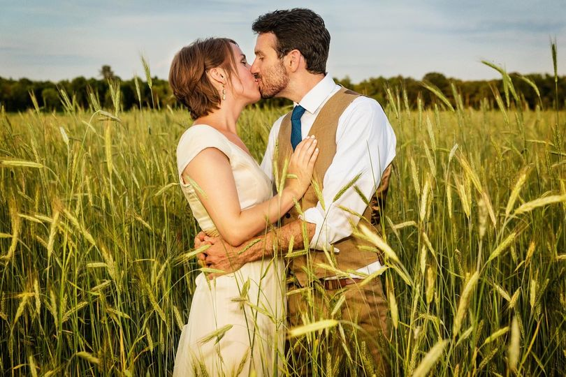 newlyweds kiss in field 51 174105 159034526366107