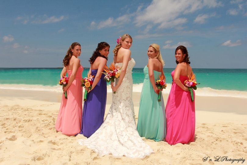 Bride and bridesmaids by the beach