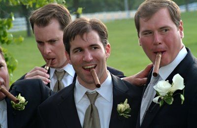 I love it when the guys get into it!  So often grooms and their groomsmen feel like pictures are...
