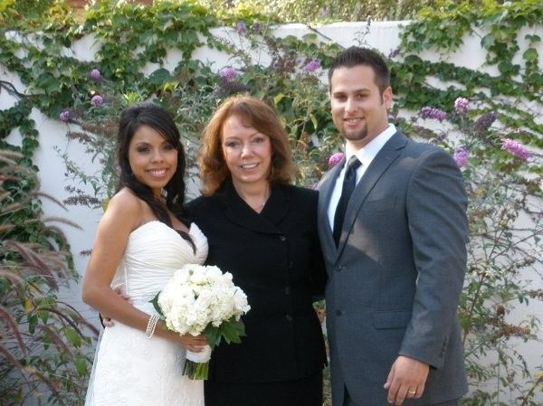 Bride and groom with the officiant