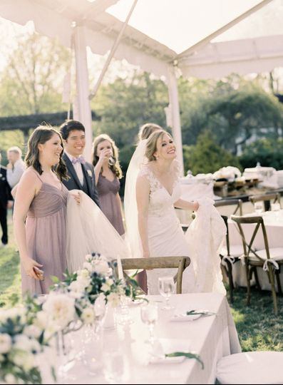 The bride assisted by her guests