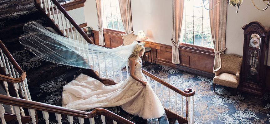 Walking down the staircase in white gown