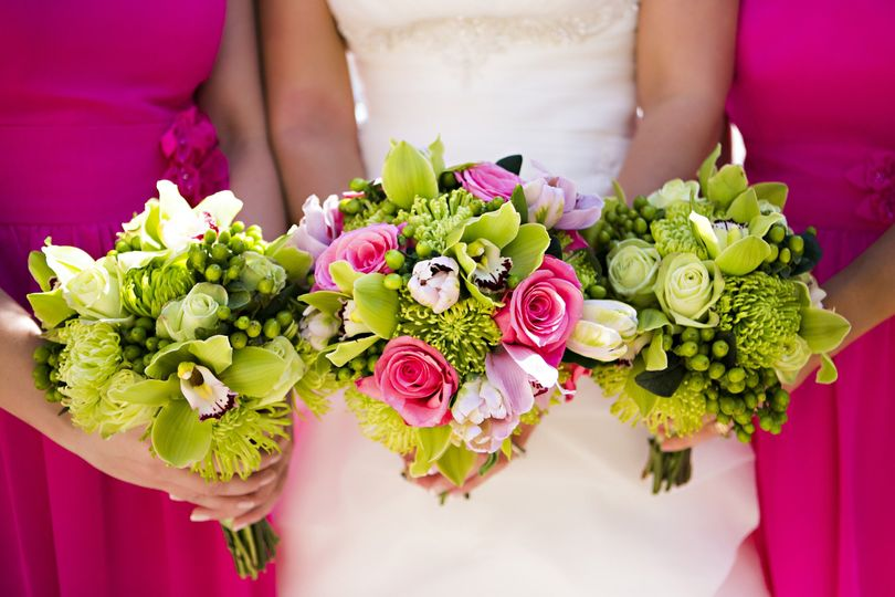 The bride with her bridesmaids holding thier bouquet