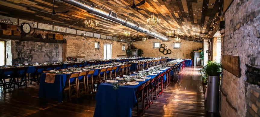 Long tables with blue tablecloths