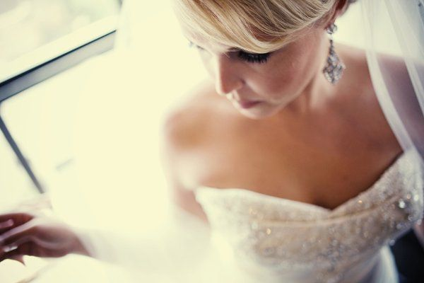 Elegant, artistic bridal portraiture. Getting ready photo. Photographed at The Oread Hotel in...
