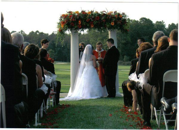 This was gorgeous wedding at a local country club.  We designed the archway and sprinkled rose...