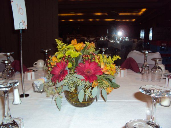 Beautiful fall themed centerpiece we designed for a September wedding.