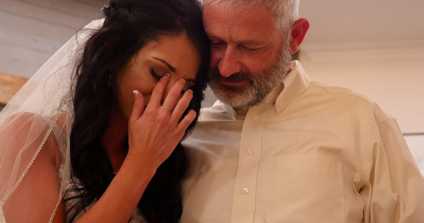 Emotion bride with father