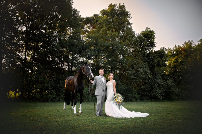 Hitched at Turkey Trac Farms - newlyweds