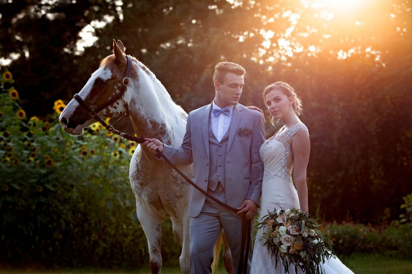 Hitched at Turkey Trac Farms - bride and groom posing with horse