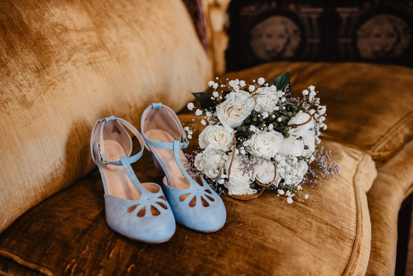 Bridal shoes and bouquet | Photo: Lacey White Photo Co