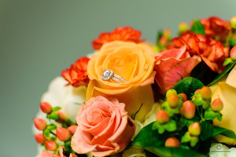 Ring hidden among colorful blooms