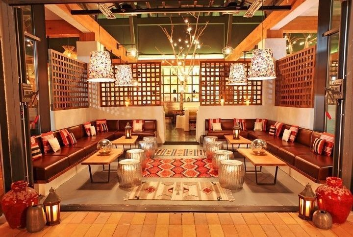 The Taos Lounge features plush leather couches, coffee tables + decorative stainless steel stools...