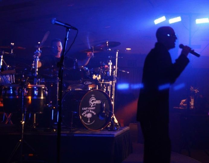 A dreamy pic of Jason MC'ing a bridal party event at a reception in Columbia SC