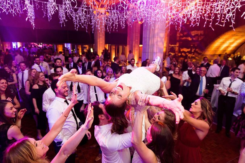 Bride crowd-surfing