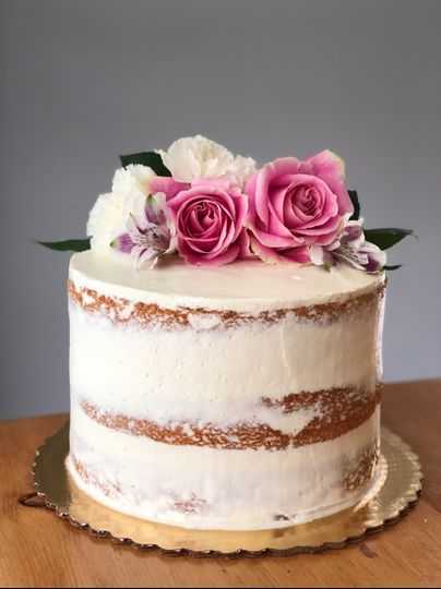 Naked cake with rose petals