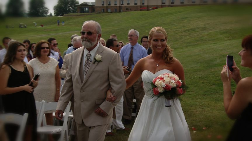 One of our favorite moments: Jennifer beams as her proud father walks her down the aisle