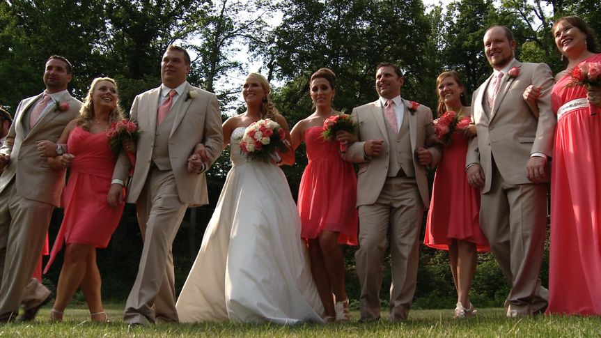 Classic summer colors of coral and taupe had the entire wedding party glowing on camera!