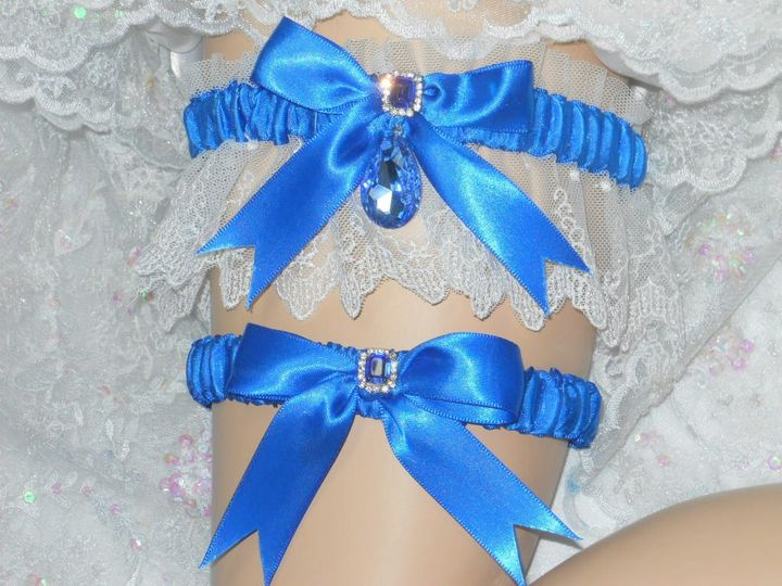 Satin and lace traditional garter with Sapphire crystal gem drop. Available in Emerald, Ruby, Pale...