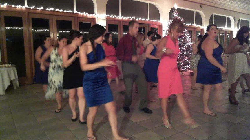 Yes the DJ can dance! teaching the guests how to do the Cupid Shuffle! December wedding reception at...