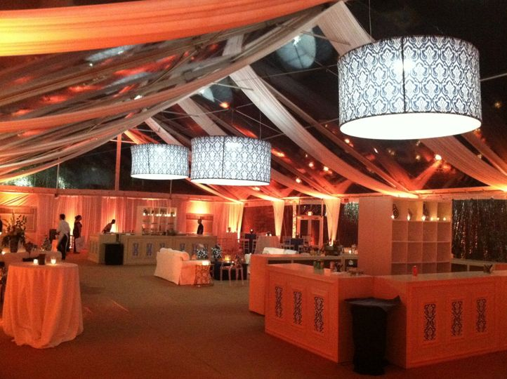 NIGHT TIME VIEW OF CUSTOM DRUM SHADES AND TENT FABRIC ENHANCEMENTS