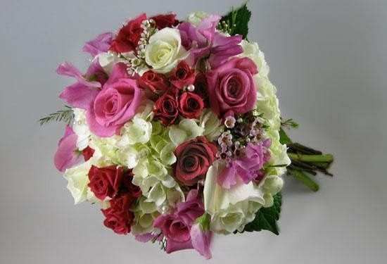 Nature Nook created this romantic and soft bouquet filled with roses and hydrangea, accented with...