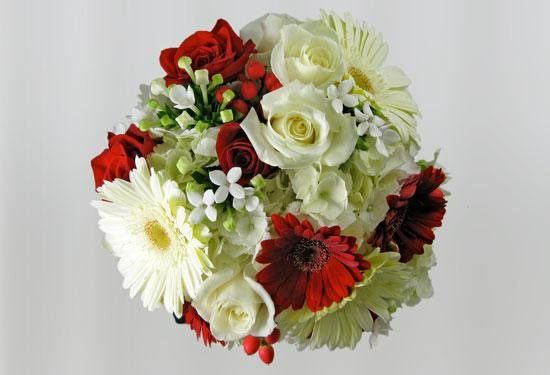 For the bride this beautiful mix of white roses, gerber daisies, stephanotis and bovardia are...