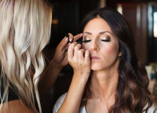 Applying eye liner