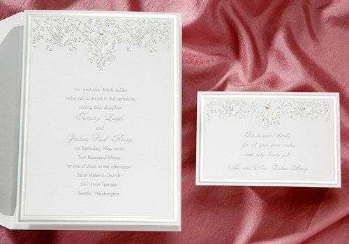 The classic silver foil stamping on this invitation is exquisite! The center elements are embossed...