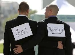 "Grooms with ""Just Married"" signboards"