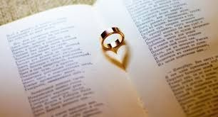 Wedding ring on a book