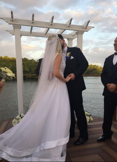 Sealed with a kiss at the ceremony on the dock