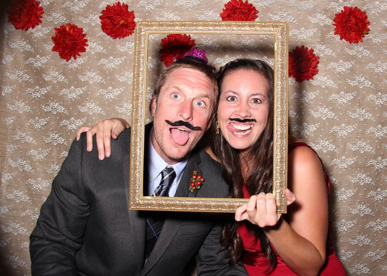 Couple photo using a mustache prop