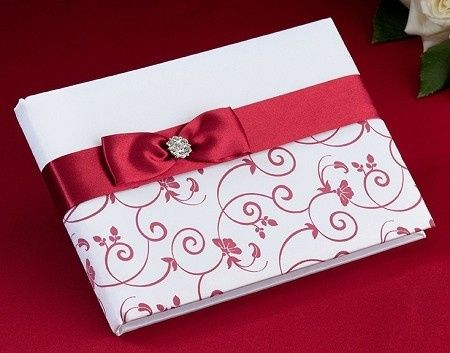 "This 8.5"" x 6"" guest book is an elegant mixture of red on white. The cover is decorated with red..."