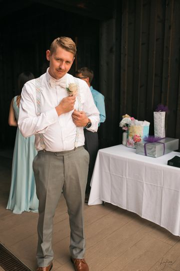 Groom fixing his boutonniere