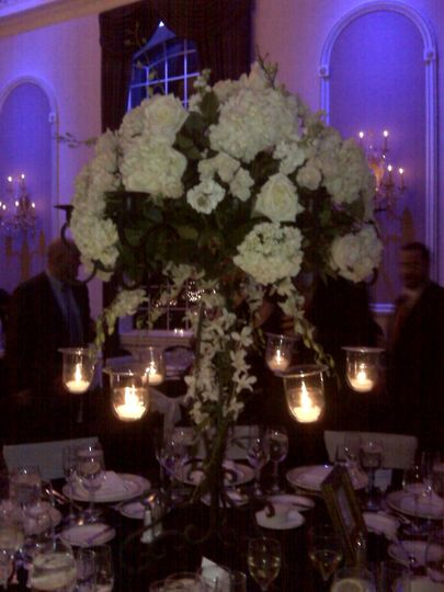cascading centerpieces with hanging votives and curly willow/orchid accents
