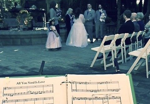 """""""All You Need Is Love."""" A cute little girl as bridesmaid helps, too."""