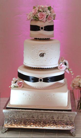 Wedding cake with black ribbons