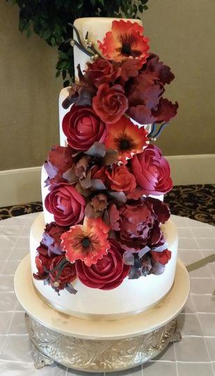Cascading flowers on cake