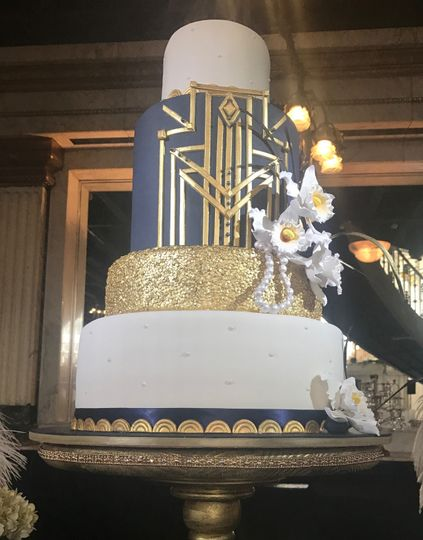 Wedding cake with black and gold tiers