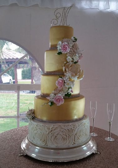 Gold wedding cake with a white base tier