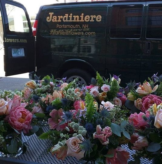 Stunning table arrangements on their way to a wedding.