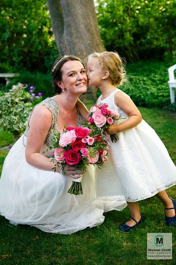 A bride with her flower girl - matching bouquets.