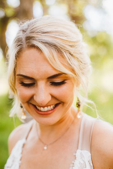 Smiling bride | Photos: Red Aspen Photography